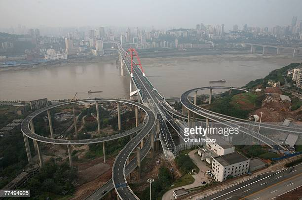 An elevated view of the construction site of the Caiyuanba Yangtze River Bridge on October 25 2007 in Chongqing Municipality China The Caiyuanba...