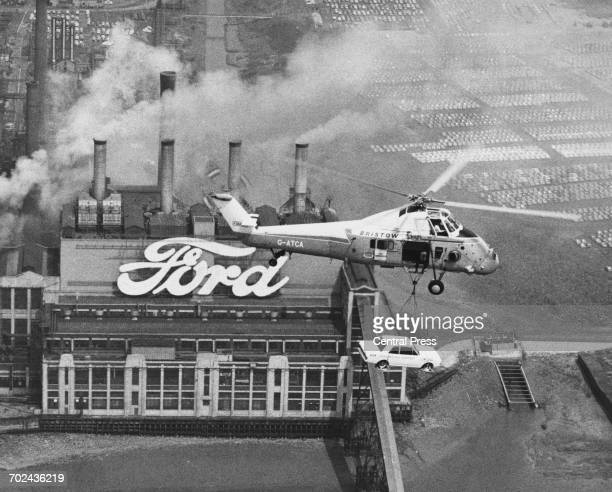 An elevated view of the Ford Motor Company Ltd engine plant factory as a Westland Wessex Mk60 helicopter of Westland Bristow carries a Ford...