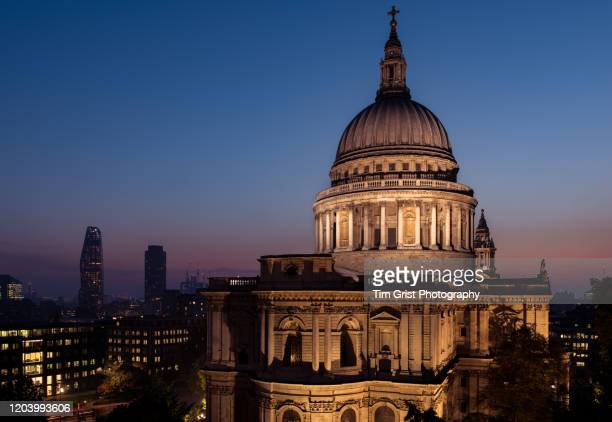 an elevated view of the illuminated st paul's cathedral and london skyline at dusk - tim grist stock pictures, royalty-free photos & images