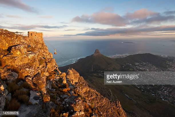 An elevated view of the Table Mountain Cable Car, taken from the top of Table Mountain with Lion's Head and Robben Island to the right. Cape Town, Western Cape, South Africa