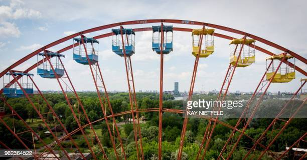 An elevated view shows a Giant Wheel at the abandoned former GDR pleasure ground 'Spreepark' in the Plaenter forest in Berlin on May 25 2018 /...