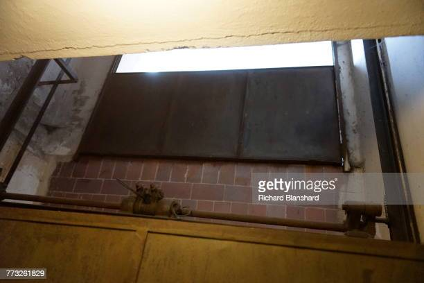 An elevator for dead bodies connecting the morgue and the crematorium at the Buchenwald German Nazi concentration camp near Weimar Germany 2014 The...