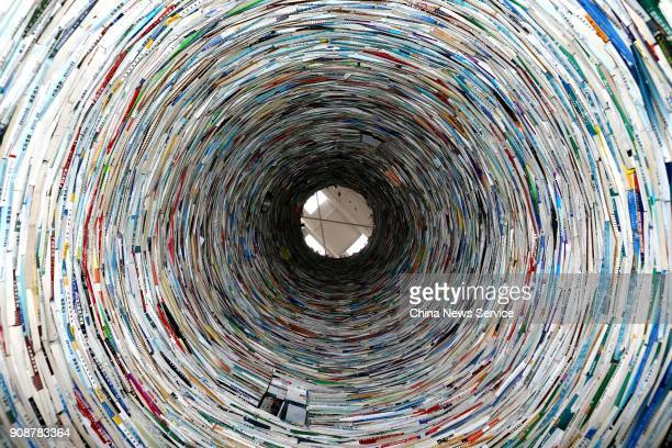 An elevenmeterhigh tower of books stands at Xi'an University of Architecture and Technology on January 22 2018 in Xi An China Artist Zhao Haitao made...