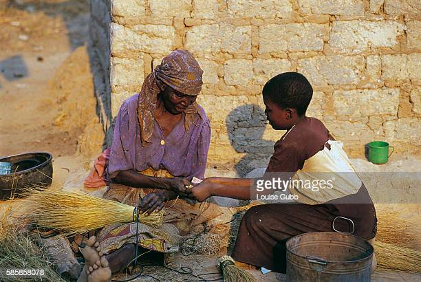 An elevenyearold girl sells her grandmother's brooms for $003 each in order to buy food in a shanty compound in Kitwe Seventy percent of the world's...