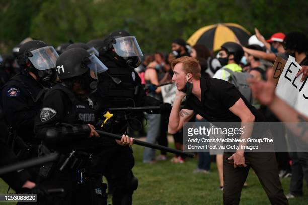 An Elijah McClain protester gets close to the Aurora police line at the Aurora Municipal Center June 27 2020 Elijah McClain died August 30 2019...