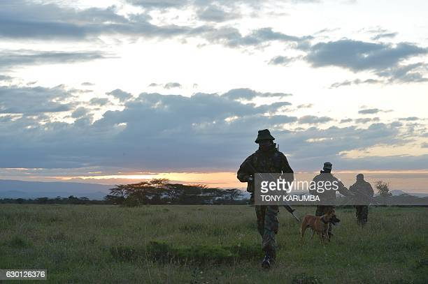 An elite antipoaching unit embarks on an evening patrol on foot on December 5 at the Ol Pejeta conservancy in Laikipia County at the foot of Mount...