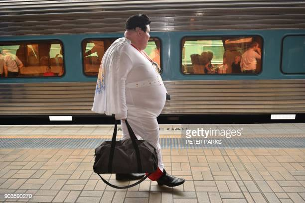An Elvis fan arrives at Central station to board a train to The Parkes Elvis Festival in Sydney on January 11 2018 The Parkes Elvis Festival is an...