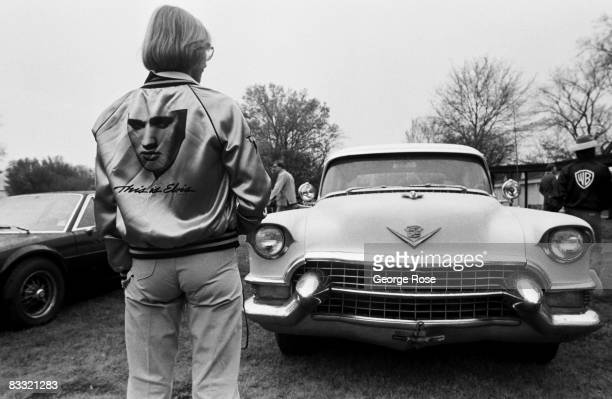 An Elvis Presley fan looks at a vintage Cadillac during a 1981 Memphis Tennessee tour of Graceland prior to the premiere of their documentary 'This...