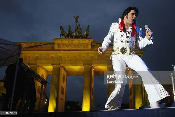 An Elvis Presley impersonator performs at the official opening ceremony and celebration of the new US embassy next to the Brandenburg Gate on July 4...