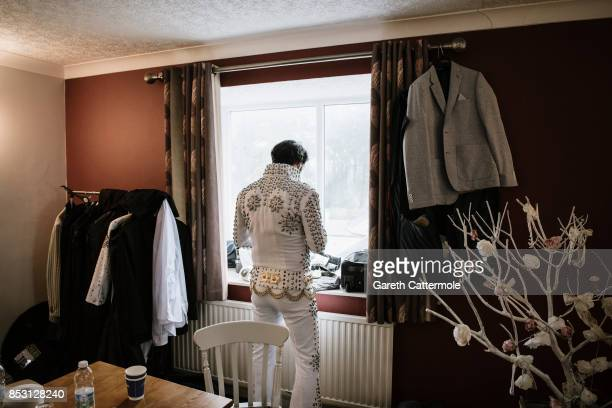 An Elvis tribute artist prepares backstage ahead of perfroming at 'The Elvies' on September 24, 2017 in Porthcawl, Wales. 'The Elvies' is an annual...