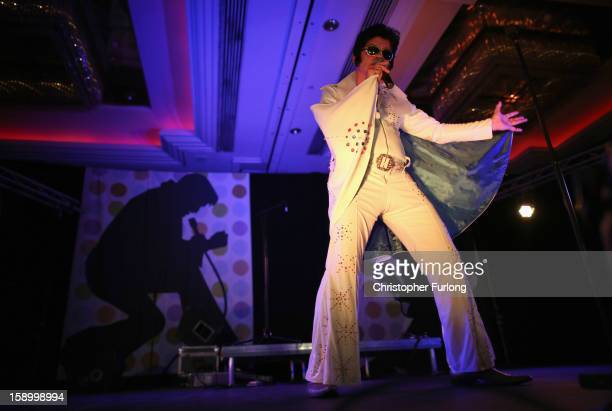 An Elvis tribute artist takes part in the European Elvis Championships at the Hilton Hotel on January 4 2013 in Birmingham England Elvis...