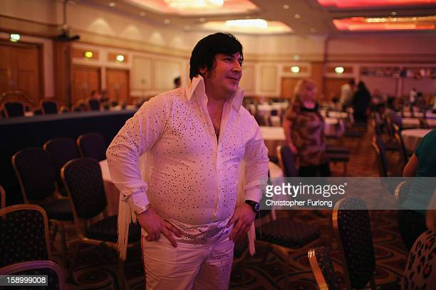 An Elvis tribute artist watches the acts during the European Elvis Championships at the Hilton Hotel on January 4 2013 in Birmingham England Elvis...