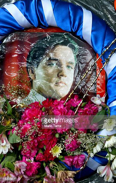 An Elvis wreath left by a fan at Elvis Presley's Graceland home is seen during Elvis Week on August 12, 2002 in Memphis, Tennessee. 75,000 fans are...