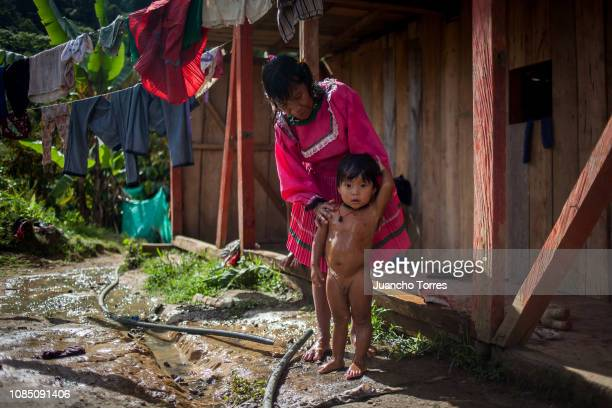 An Embera mother baths his child on December 15 2018 in Santa Cecilia Risaralda Colombia The Embera had to abandon their territories of origin to...