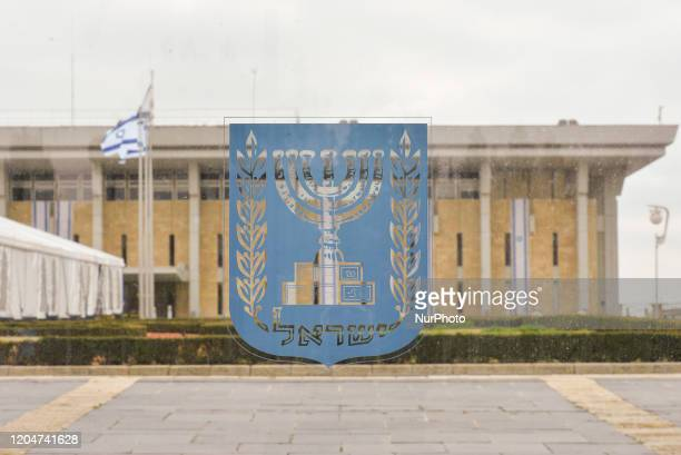 An emblem of Israel with the Knesset in the background seen on the day of Israeli Legislative Elections 2020 in Central Jerusalem On Monday March 2...