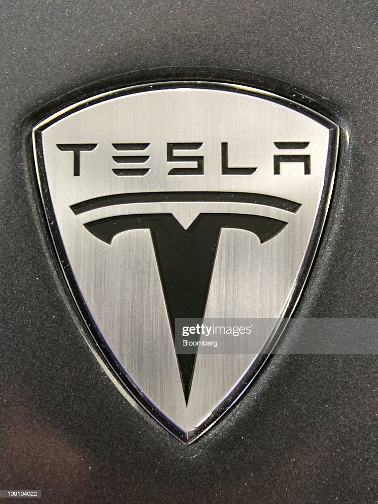 An emblem of one of Tesla Motors Inc.'s Roadsters is seen at the company's headquarters in Palo Alto, California, U.S., on Thursday, May 20, 2010. Toyota Motor Corp. will acquire a $50 million stake in California electric-car maker Tesla Motors Inc. as automakers compete to introduce less-polluting vehicles in the U.S. Photographer: Tony Avelar/Bloomberg via Getty Images