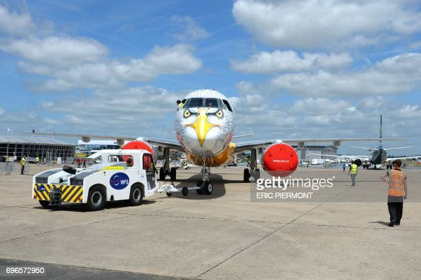 An Embraer E 195 E2 moves on the tarmac on June 16, 2017 in le Bourget near Paris prior to the opening of the International Paris Air Show on June...