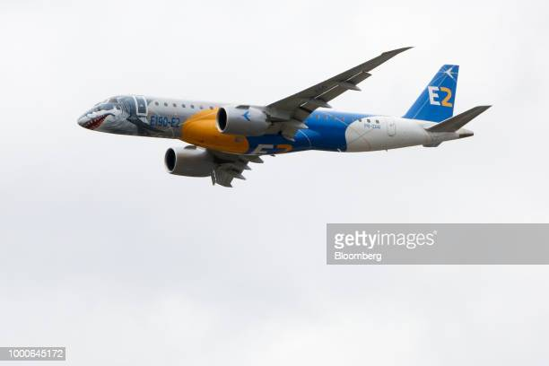 An Embraer SA E190 E2 passenger aircraft performs during the flying display program on day two of the Farnborough International Airshow 2018 in...