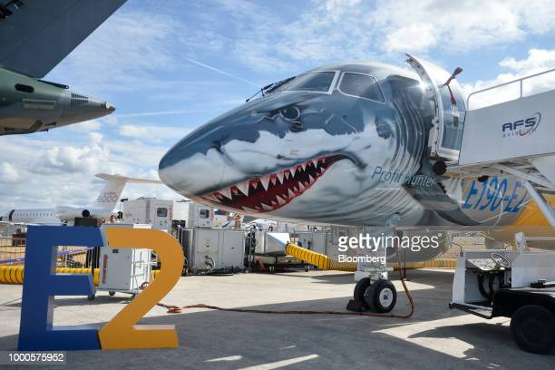 An Embraer SA E190E2 passenger aircraft stands on display on day two of the Farnborough International Airshow 2018 in Farnborough UK on Tuesday July...