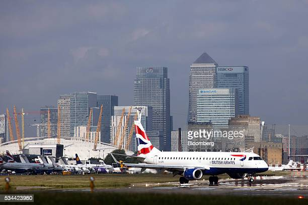 An Embraer SA EJet passenger aircraft operated British Airways a unit of International Consolidated Airlines Group SA prepares to take off from...