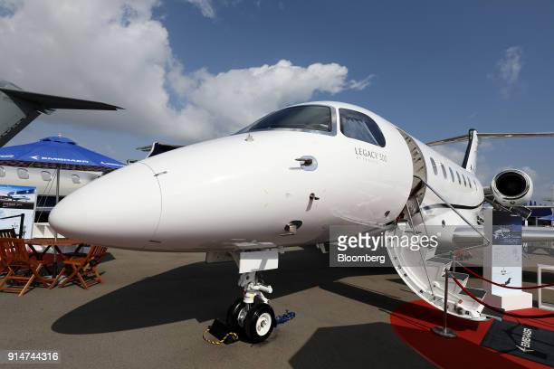 An Embraer SA Legacy 500 jet sits on display during the Singapore Airshow held at the Changi Exhibition Centre in Singapore on Tuesday Feb 6 2018...