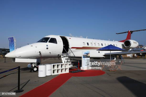 An Embraer SA Legacy 650E jet sits on display during the Singapore Airshow held at the Changi Exhibition Centre in Singapore on Tuesday Feb 6 2018...