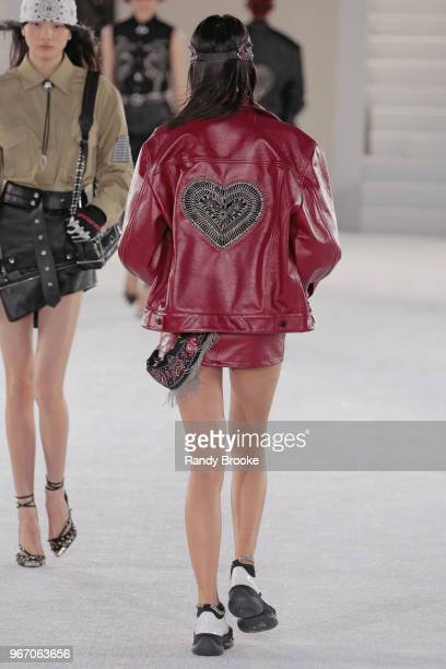 An embroidered heart on the back of a red leather jacket during the Alexander Wang Resort Runway show June 2018 New York Fashion Week on June 3 2018...