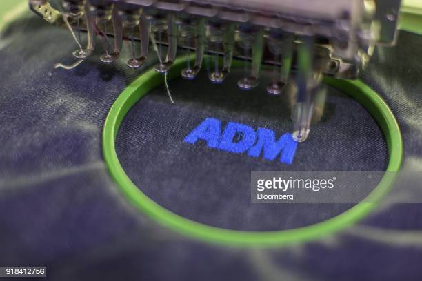An embroidery machine stitches the Artistic Denim Mills Ltd logo into a piece of a denim at the company's factory in Karachi Pakistan on Tuesday Feb...
