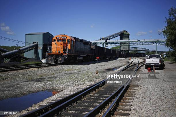 An EMD GP40PH2 locomotive pushes cars loaded with metallurgical coal into a rotary dumper at the SunCoke Energy Partners LP Ceredo Terminal in Ceredo...