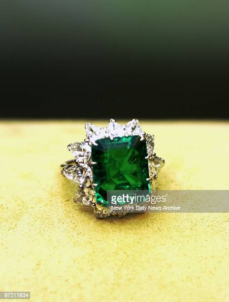 An emerald and diamond ring from Elizabeth Taylor's private collection is on display at Christie's auction house as a preview of the main exhibit...