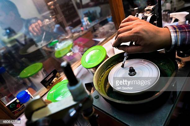An emerald cutter polishes a gemstone in a cutting and polishing workshop on February 07 2014 in Bogota Colombia Approximately 60 percent of the...