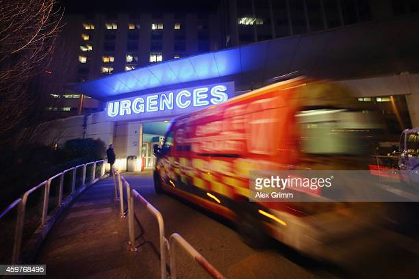 An emergency ambulance arrives at the Grenoble Hospital where former German Formula One driver Michael Schumacher is being treated for a severe head...