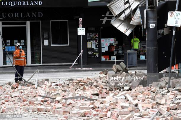 An emergency and rescue official examine the damage to a building in the popular shopping Chapel Street in Melbourne on September 22 after a 5.9...