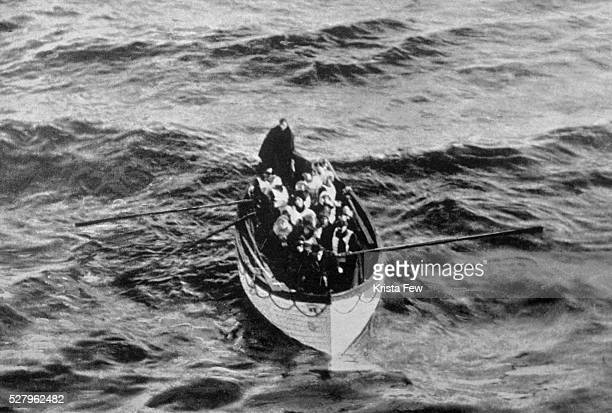 An emergency cutter lifeboat carrying a few survivors from the Titanic seen floating near the rescue ship Carpathia on the morning of April 15 hours...