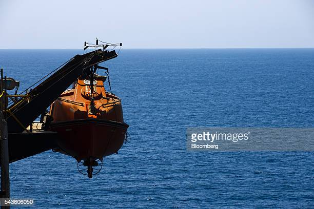 An emergency escape vessel hangs from the side of the Casablanca oil platform operated by Repsol SA in the Mediterranean Sea off the coast of...