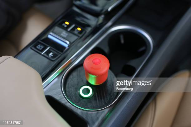 An emergency manual override button sits inside a Hyundai Motor Co Sonata vehicle operated by YandexTaxi part of YandexNV during a selfdriving taxi...