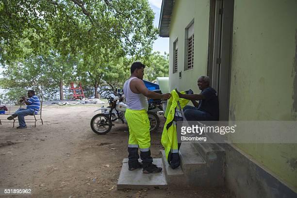 An emergency medical technician puts his reflective uniform on outside of the Manzanillo Fire Department in Manzanillo Monte Cristi Province...