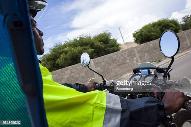 An emergency medical technician rides a USAID donated motorcycle equipped with a sidecar gurney through Manzanillo Monte Cristi Province Dominican...