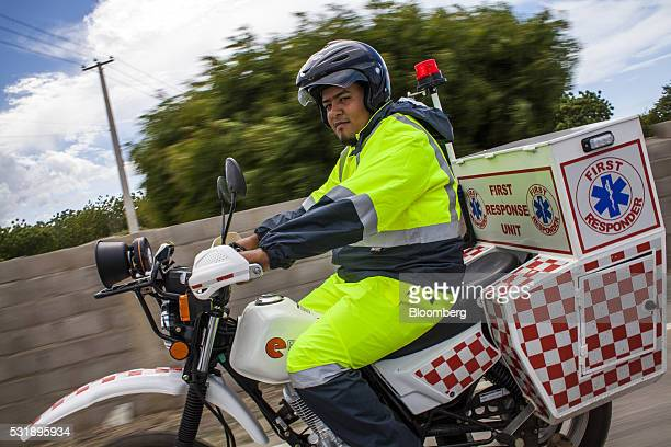 An emergency medical technician rides a USAID donated motorcycle through Manzanillo Monte Cristi Province Dominican Republic on Tuesday May 10 2016...