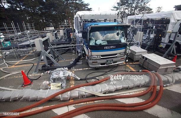 An emergency reactor water injection pump is seen at Tokyo Electric Power Co 's tsunamicrippled Fukushima Daiichi nuclear power plant during a media...