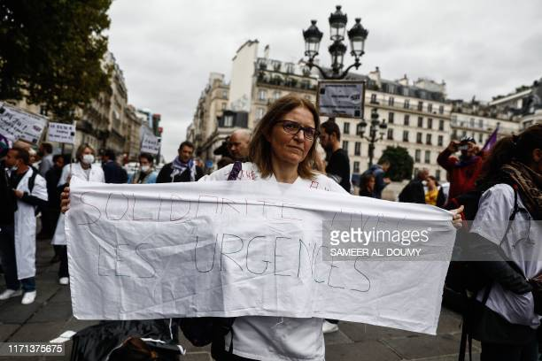 An emergency services and public hospital holds a banner reading Solidarity with emergencies during a demonstration to denounce the lack of human...