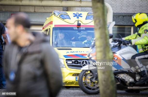 An emergency services vehicle is parked near the International Criminal Tribunal for the former Yugoslavia in The Hague on November 29 2017 The...