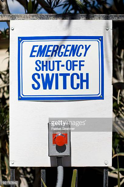 An EMERGENCY SHUT-OFF SWITCH sign and button