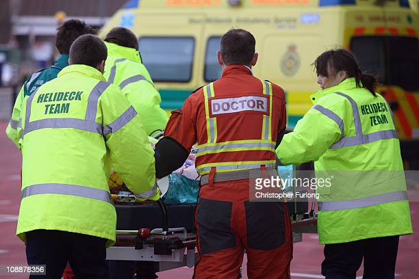 An emergency team from the West Midlands Air Ambulance deliver a serious injured patient to the Accident and Emergency department at the recently...