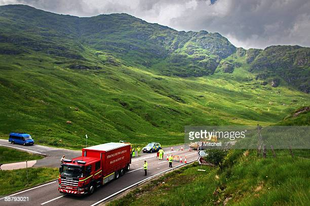 An emergency vehicle goes through a police road block on the A83 in Argyll near to where an RAF Tornado has crashed on July 2 2009 in Scotland The...