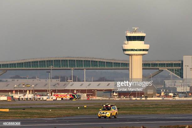 An emergency vehicle inspects the runway ahead of Virgin Atlantic flight VS43 making an emergency landing at Gatwick Airport in West Sussex on...