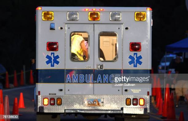 An Emery County ambulance leaves the Crandall Canyon coal mine August 16 2007 near Huntington Utah Several ambulances and a MEDEVAC helicopter...