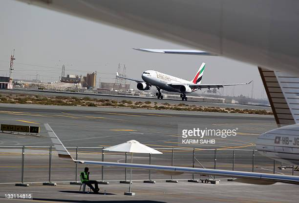 An Emirates Air Airbus lands at Dubai International airport on November 17 on the last day of the Dubai air show Gulf carriers marked their ambition...