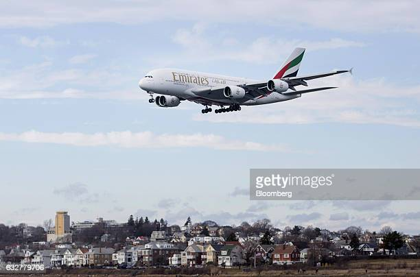 An Emirates Airbus A380 plane prepares to land at Logan International Airport in Boston Massachusetts US on Thursday Jan 26 2017 The Airbus A380...