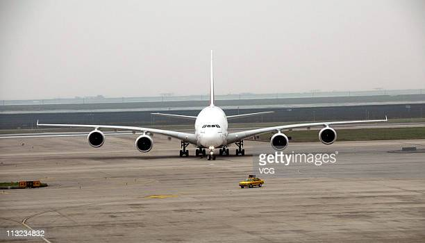 An Emirates Airbus A380 plane taxies on tarmac after touchdown at the Pudong International Airport on April 27 2011 in Shanghai China The Flight...